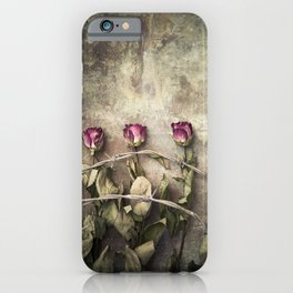 Three dried roses and barbed wire iPhone Case