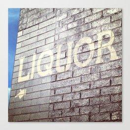 Liquor - Brick storefront and blue sky Canvas Print