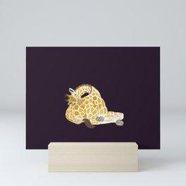 Giraffe sleeping on its own bottom Mini Art Print