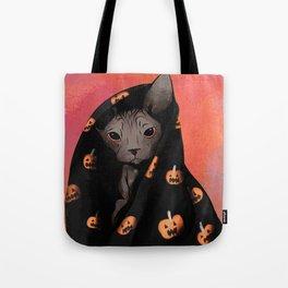 Brown Sphynx Cat Snuggled Up In a Halloween Pumpkin Blanket Tote Bag