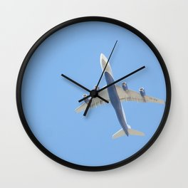 Flying plane enveloped in air Wall Clock