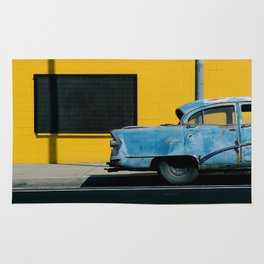 Rusty Blue Car and Yellow Wall Rug
