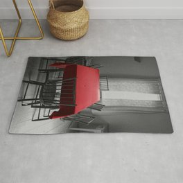 Red Table Cloth on Gray Rug
