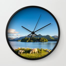 Sheep grazing on the lush shores of Lake Derwentwater, England Wall Clock