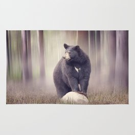 Black bear on a rock  in the woods Rug