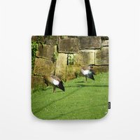 ducks Tote Bags featuring ducks by Mathilde Nieuwenhuis