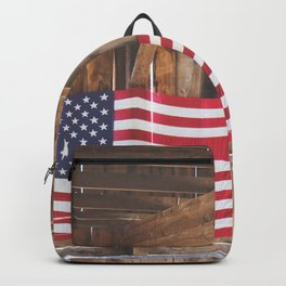 Rural American Flag in a Traditional Rustic Barn Backpack