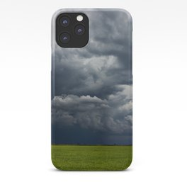 Supercell storm clouds above meadow with green grass Summer Storm clouds iPhone Case