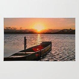 Boat at sunset Rug