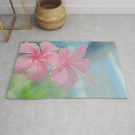 Tender macro shoot of pink hibiscus flowers Rug