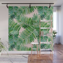 Green palm leaves on a light pink background. Wall Mural