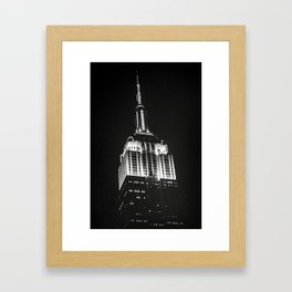 Dramatic Empire State Building in New York City at night Framed Art Print