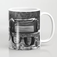 backpack Mugs featuring Camera and Backpack  by Giulia Photos