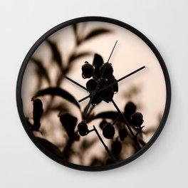 raindrops and hedge berries Wall Clock