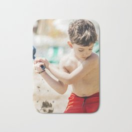 Young boy playing on a beach in French Riviera Bath Mat