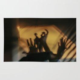 Strange hands in dark and light, parts of body, dancers, fingers Rug
