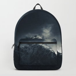 Darkness and storm clouds over mountains Backpack