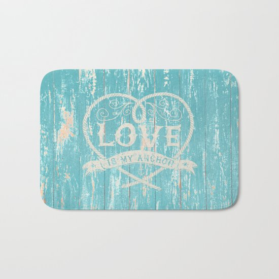 Maritime Design- Love is my anchor on aqua grunge wood background Bath Mat