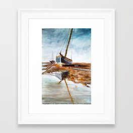 silent beached sailboat Framed Art Print