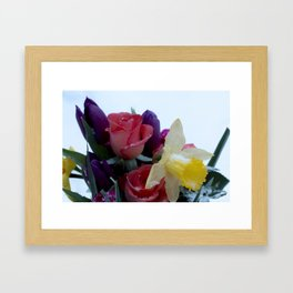 Vibrant bouquet of flowers in the snow Framed Art Print