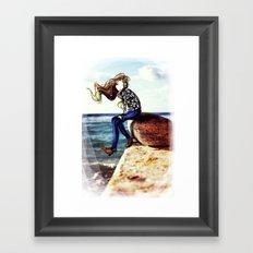 Girl on a stone Framed Art Print