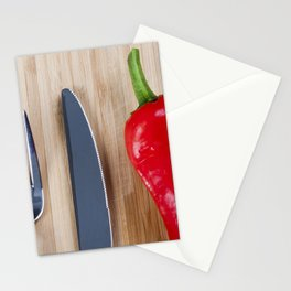 Red pepper on chopping board Stationery Cards