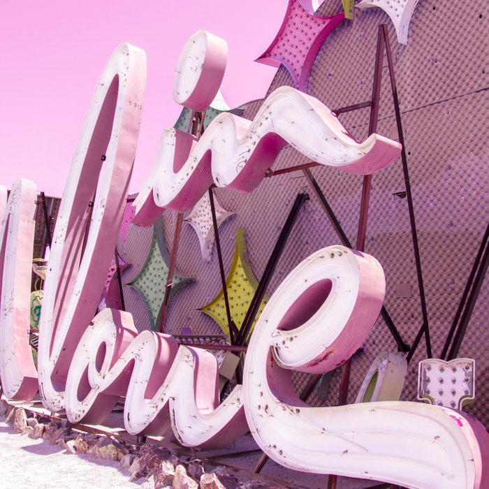 """Pink """"In Love"""" Sign at the Neon Museum in Las Vegas, Nevada Comforters"""
