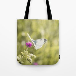 Butterfly on a spring flower Tote Bag