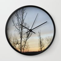 rileigh smirl Wall Clocks featuring Sunset by Rileigh Smirl