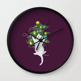 Cuttie Cat having fun with a ball of thread near Xmas Tree Wall Clock
