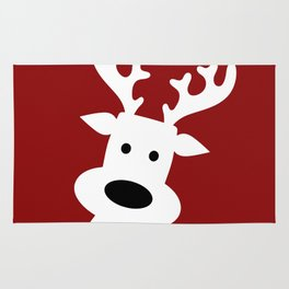 Reindeer on red background Rug