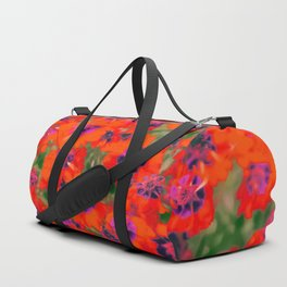 blooming red flower with green leaf background Duffle Bag