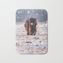 Bison in the snow Bath Mat