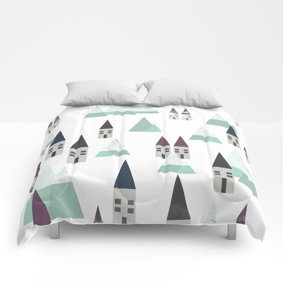 Village on winter Comforters