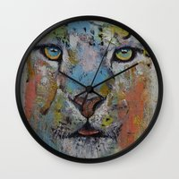 snow leopard Wall Clocks featuring Leopard by Michael Creese