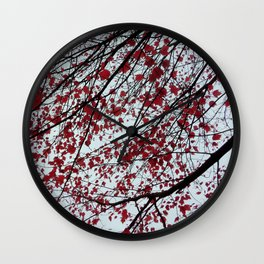 scarlet maple leaves in the sky Wall Clock