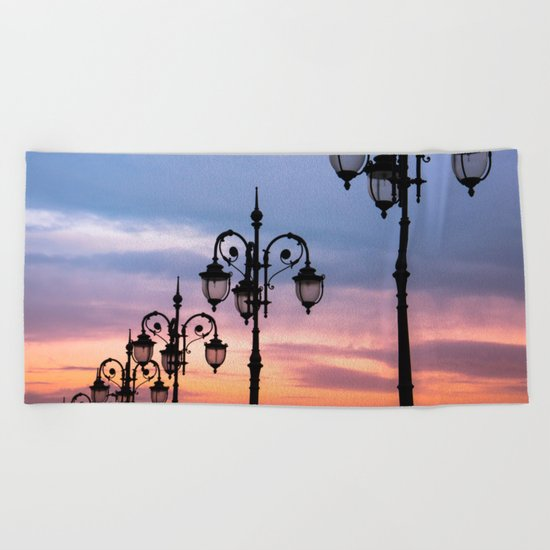 city lights in the evening sky Beach Towel