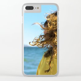 Young bonde woman shakes her curly hair at the beach Clear iPhone Case