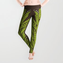 Floral tropical green leaves on brown background Leggings