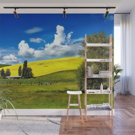Yellow blossoming rapeseed hillside and farm idyllic landscape photograph Wall Mural