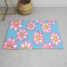 Pink and White Flowers on Blue Rug
