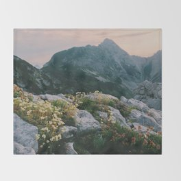 Mountain flowers at sunrise Throw Blanket