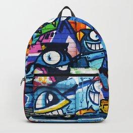 Graffiti Urban colorful graffiti city wall comical cartoon fish with big eyes doing graffitis Backpack