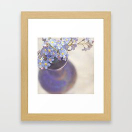 Forget me nots in blue vase. Framed Art Print