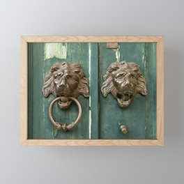 Lion heads of precious metal Framed Mini Art Print