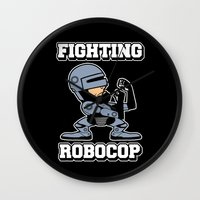robocop Wall Clocks featuring Fighting Robocop by Buby87