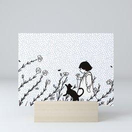 Vintage child in blue, walking in wild flowers Mini Art Print