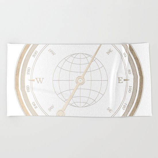 Gold Compass on White Beach Towel
