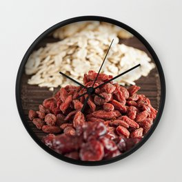 Seeds of goji, oats, walnuts and blueberries Wall Clock