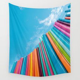 Colorful Rainbow Pipes Against Blue Sky Wall Tapestry